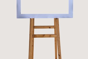 wooden easel with blank frame
