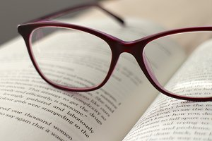 Book and eye glasses