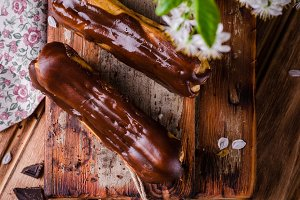 Glazed chocolate eclairs. Top view