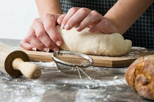 Woman kneading bread