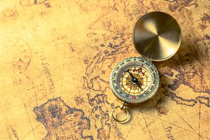 Old compass on vintage