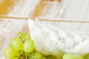Grapes in basket on wooden table background with some place for text