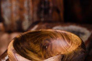 Wooden bowl on vintage background