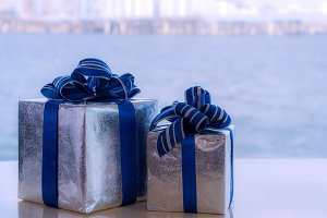Gift boxes with blue ribbons