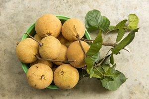 Santol fruit in basket. Top view