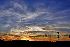 crane silhouette at sunset