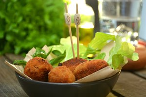 Plate full of croquettes of ham