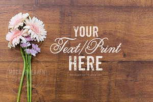 Rustic Flowers on Wood Desk Mockup
