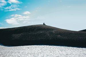 Icelandic mountain landscape with alone man in Landmannalaugar