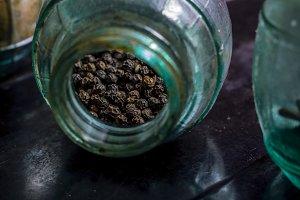 Peppercorns in a vintage jar
