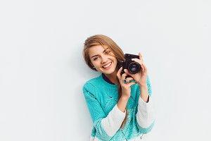 woman using vintage camera