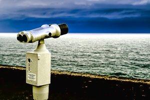 Binoculars, watching the skyline