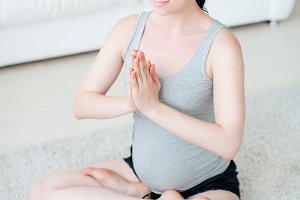 Young pregnant woman do yoga