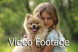 Little girl stroking Spitz