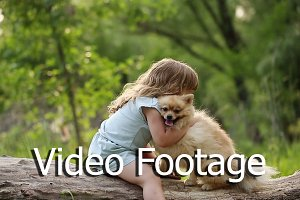 Little girl hugging Spitz.
