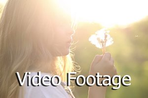 Little girl blow a dandelion
