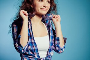 young woman in plaid shirt