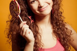 happy young woman with lollipop