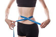 Girl measures waist. Weight loss