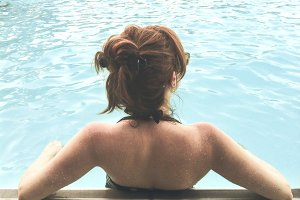 Woman Leaning on the Edge of a Pool