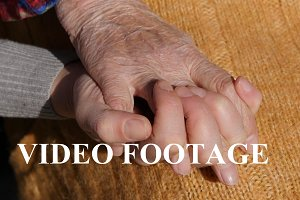 Hands comforting an elderly hands