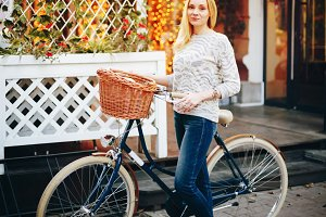 Stylish woman on a vintage bicycle