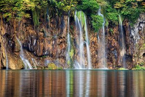 Waterfall With Reflection On Water