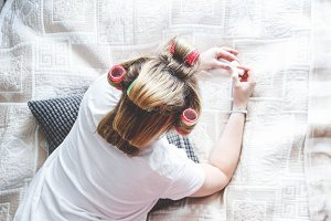 Girl with curlers on her head