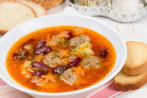 Soup with meatballs and beans