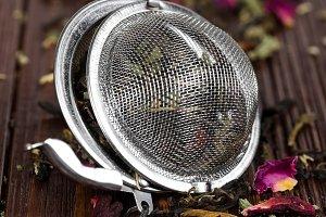 Green herbal tea in strainer