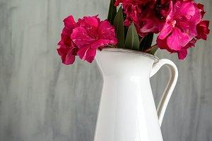 flowers in white enamel pitcher