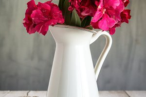 flowers in white enamel pitcher