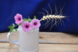 ear of barley and hanging flowers