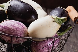 Eggplants in metal basket