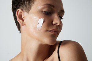 woman with a cream on a cheek
