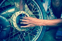 mechanic changing motorcycle tire