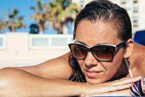 Woman with sunglasses enjoy summer