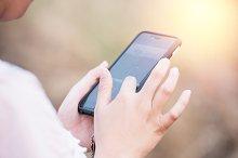woman playing smartphone