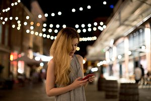 Girl looking in to smartphone