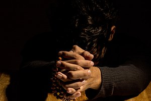 man hands in prayer