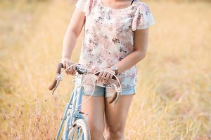 Asian woman with bicycle