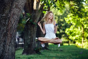 girl levitates in nature