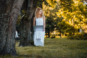 girl levitates with laptop