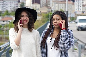 young women talking on the phone