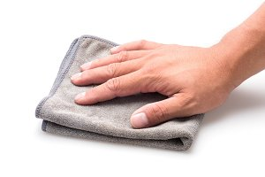 Hand and gray rag cleaning