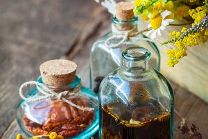Bottles of tincture and herbs
