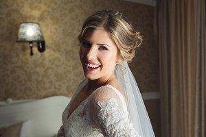 Bride posing in a hotel room