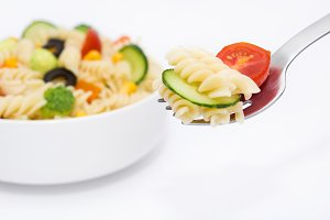 Pasta salad on a fork