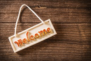 Welcome sign on wooden