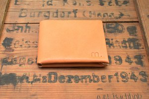Leather Wallet on Wooden Surface